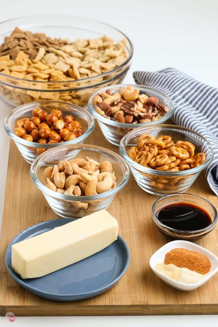 ingredients in individual bowls for chex mix oven baked