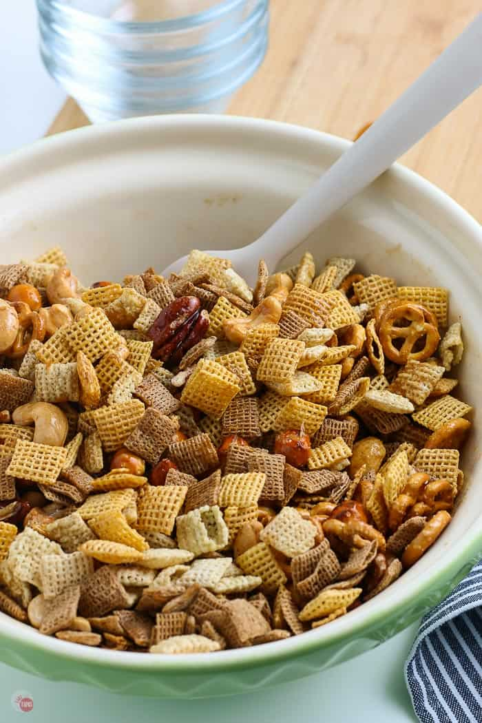 chex mix in a bowl with a spatula