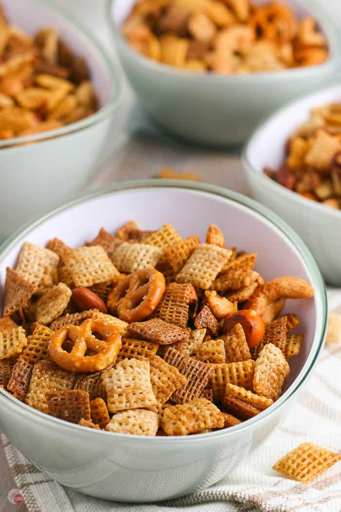 side view of 4 bowls of snack chex mix
