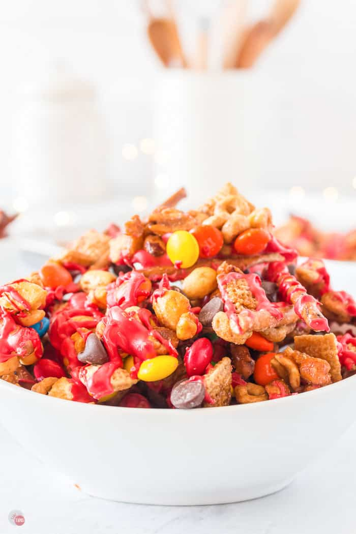 elf snack christmas chex mix in a white bowl
