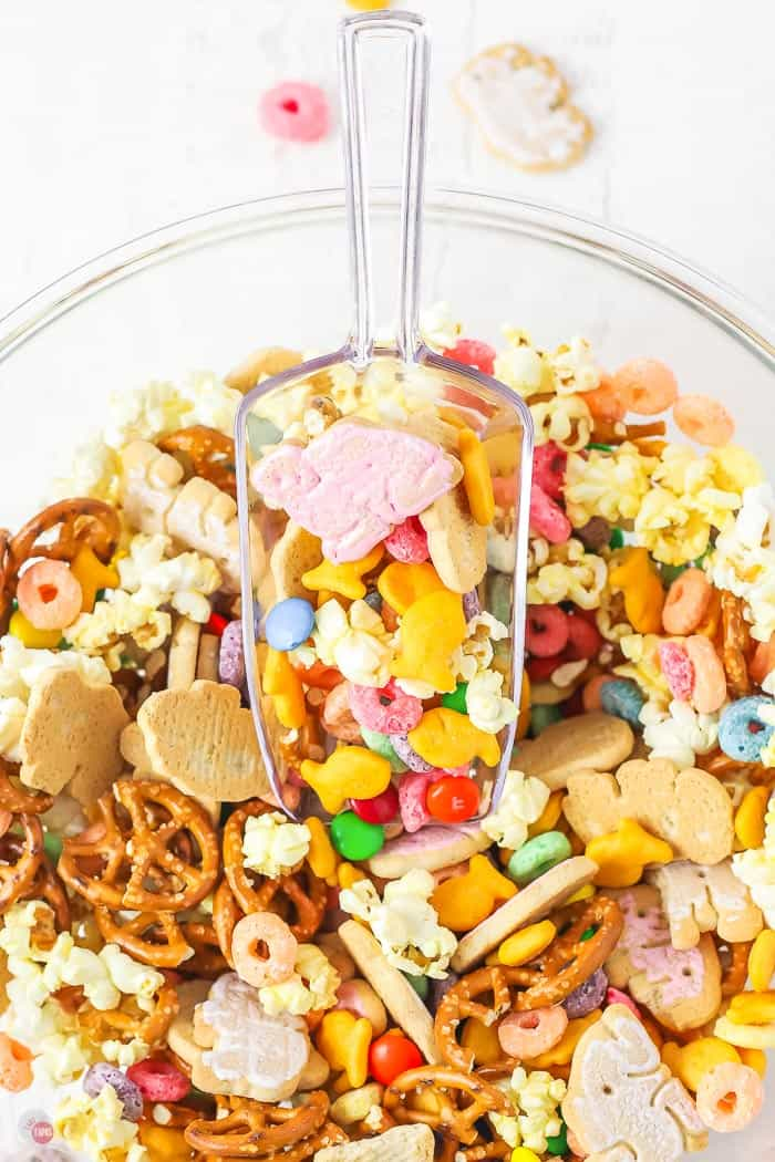 bowl of snacks with a scoop