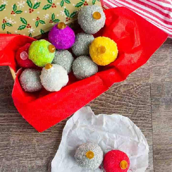 oreo balls looking like ornaments in a box