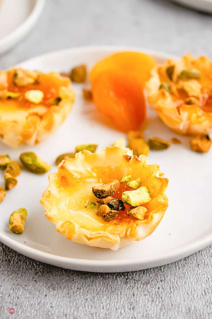 white plate with apricot phyllo cups