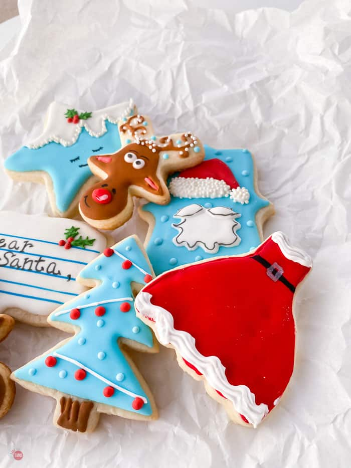 decorated sugar cookies on paper