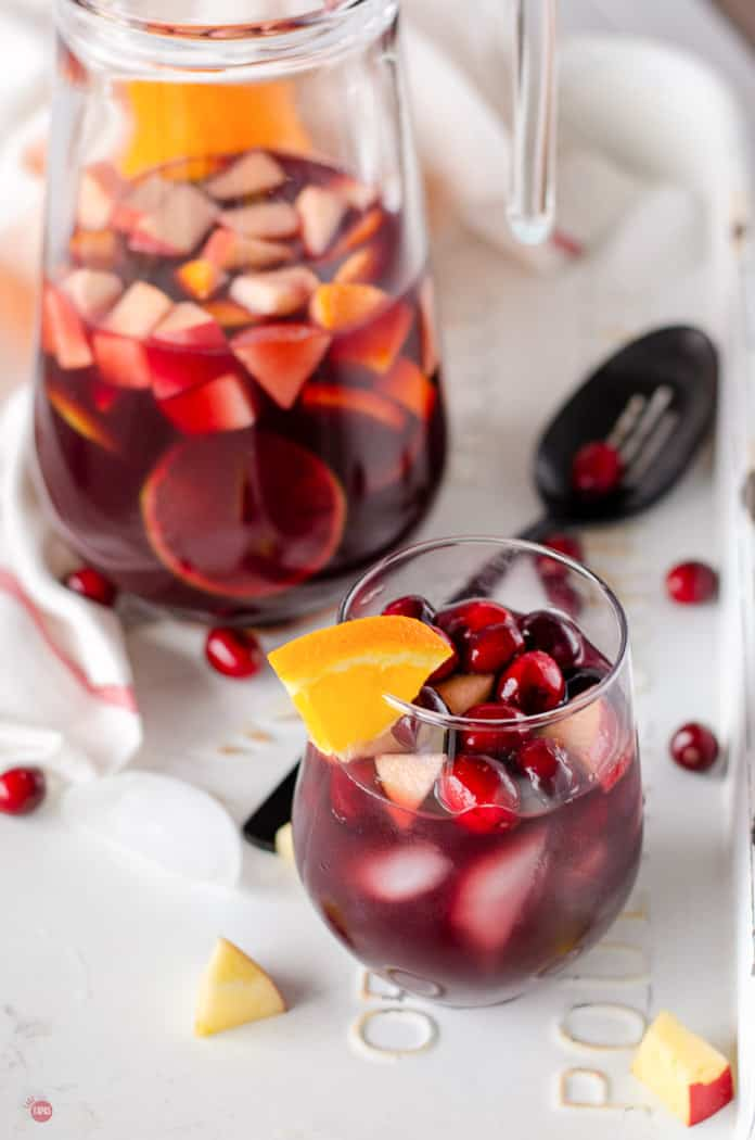 pitcher of sangria with glass