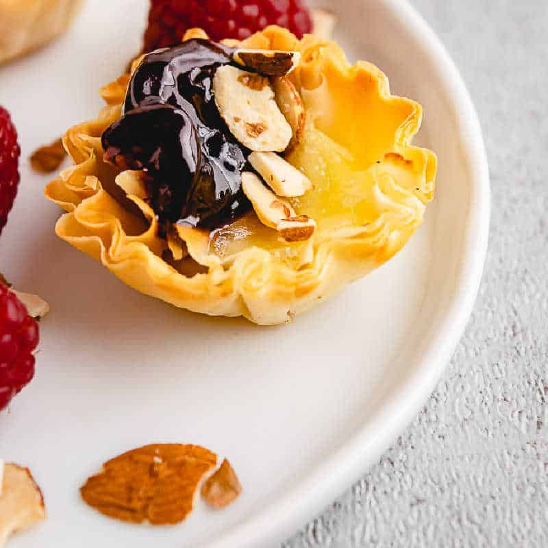 phyllo cup on white plate with almonds