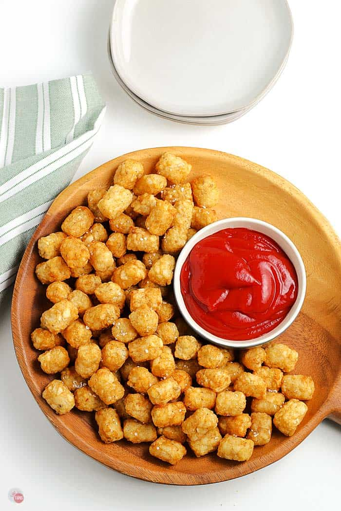 overhead picture of tater tots on a wood platter