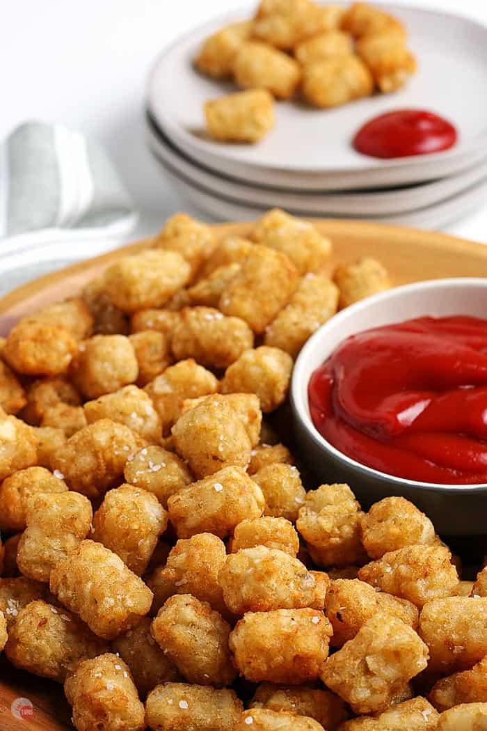 close up of tater tots on platter