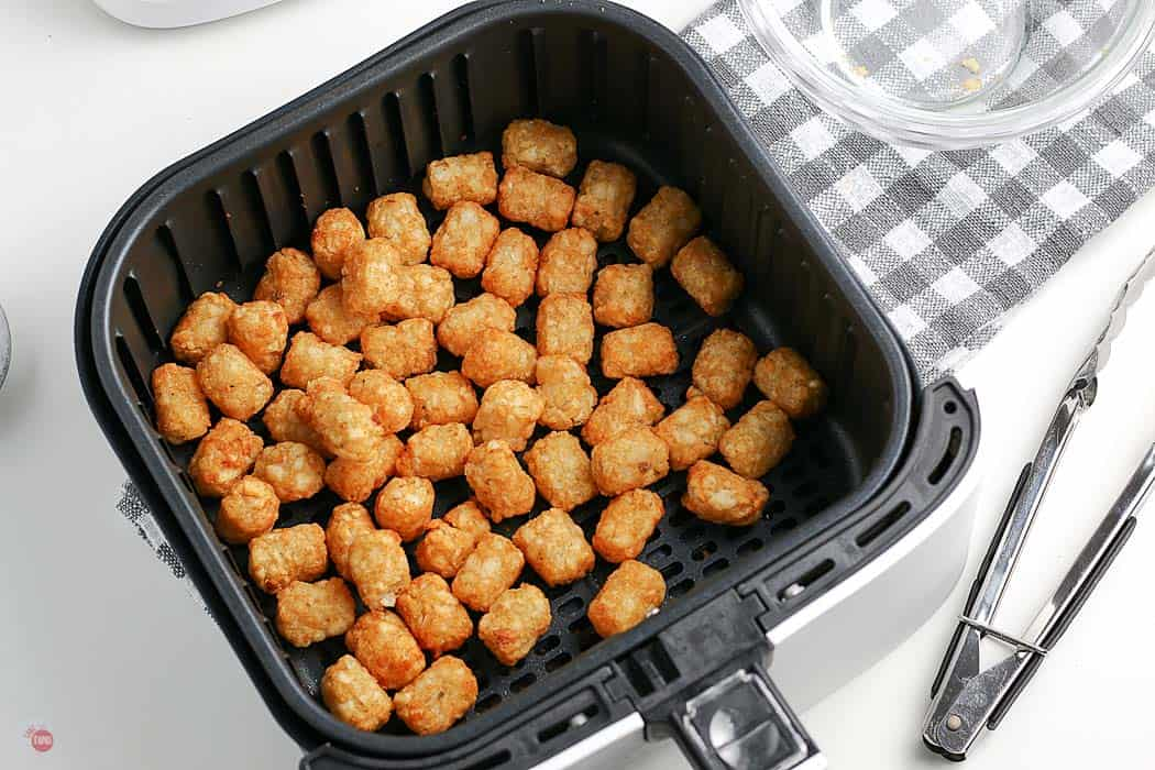 cooked tater tots in a basket