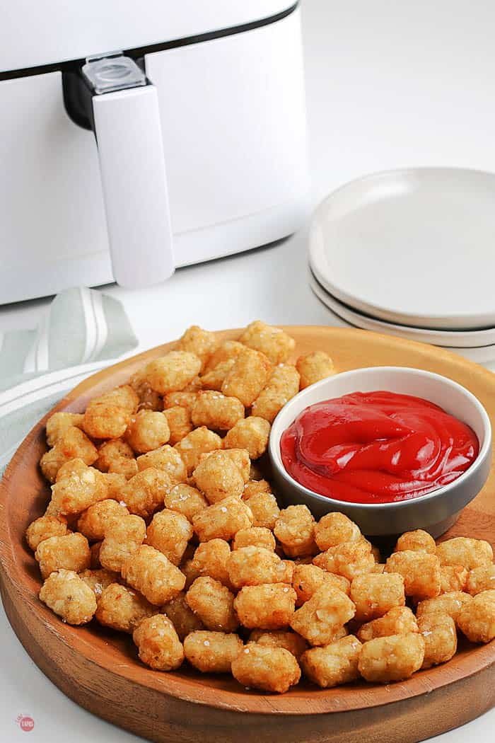 tots on a platter with ketchup