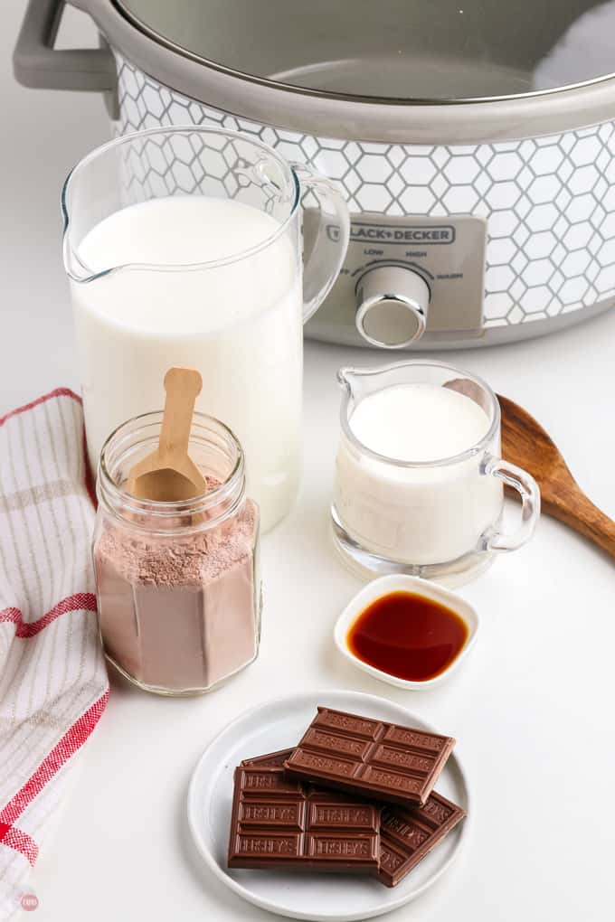 hot cocoa ingredients in front of a crock pot