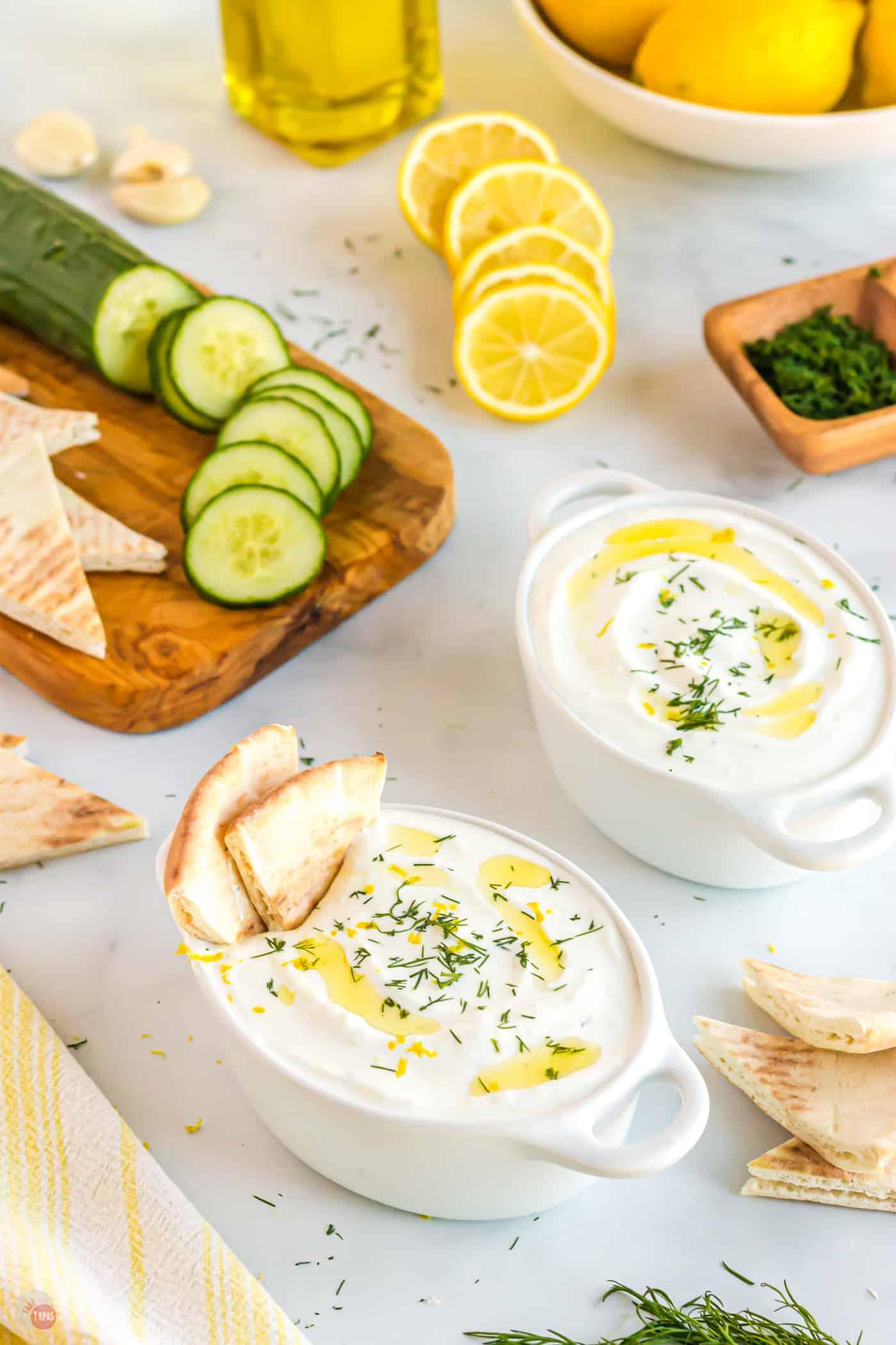 bowls of greek yogurt sauce with pita
