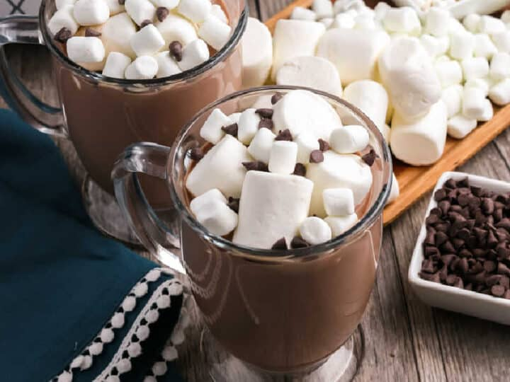 two mugs of hot cocoa with marshmallows