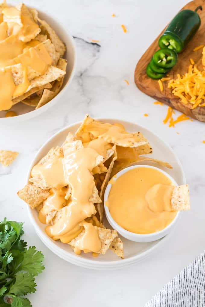 bowl of chips and cheese sauce