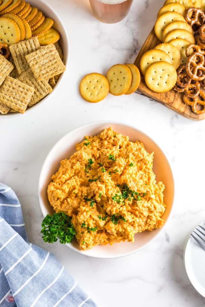 cheese spread in a bowl with crackers