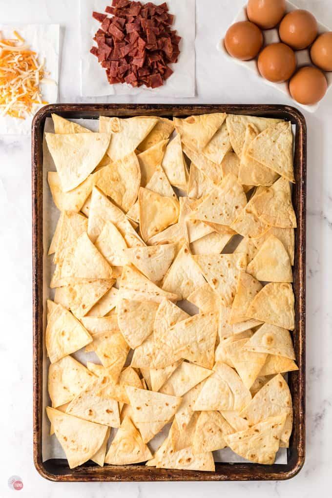 tortilla chips on a baking sheet