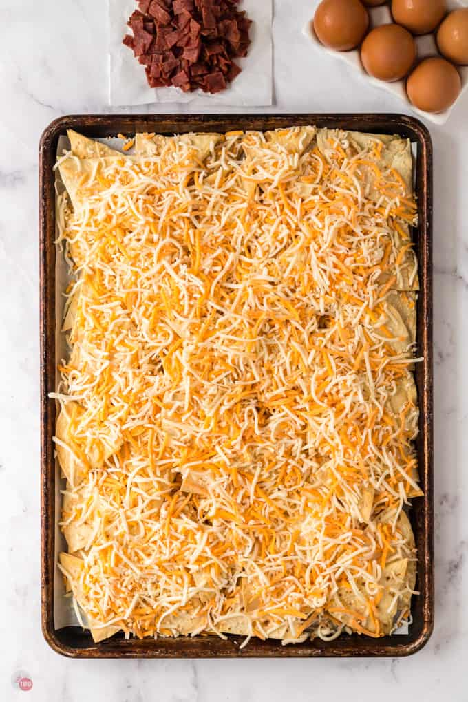 cheese and chips on a baking sheet