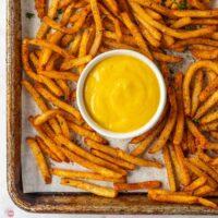 pan of cajun fries with dipping sauce
