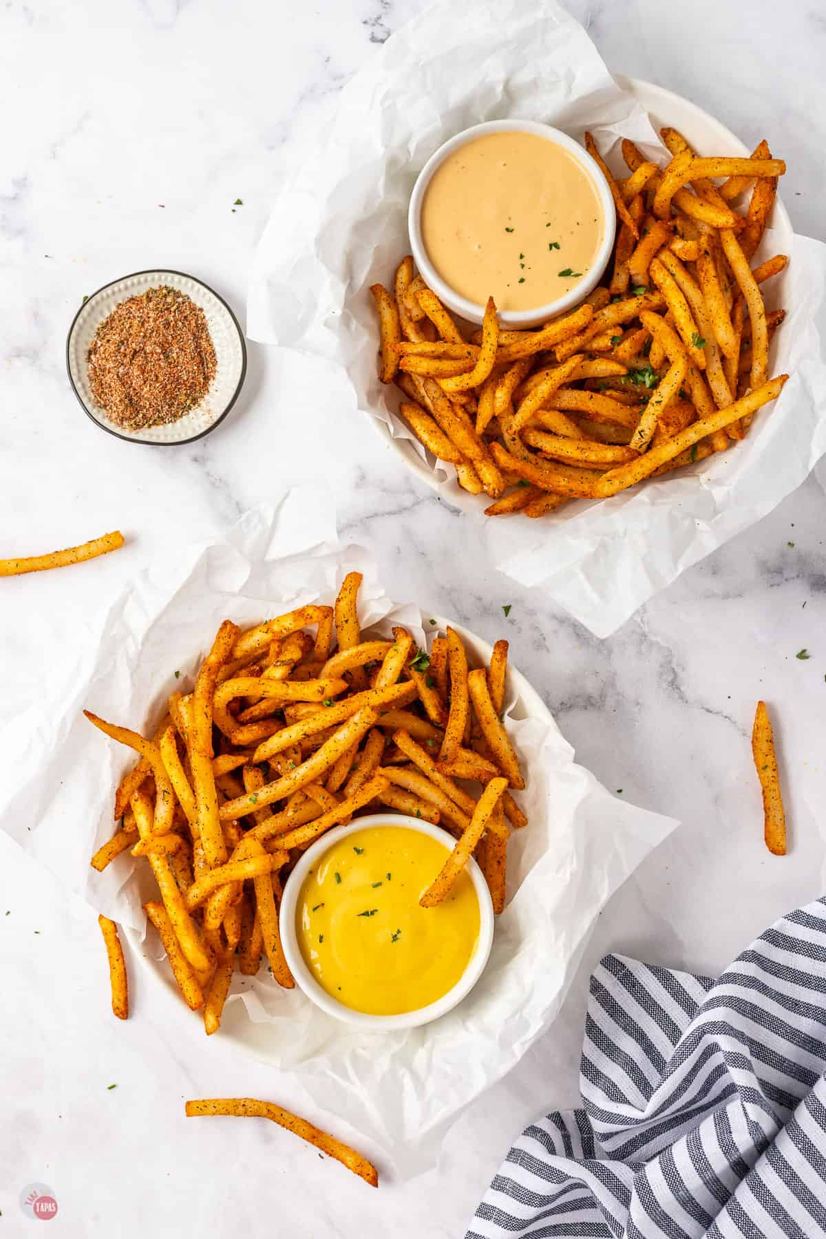 two bowls of french fries
