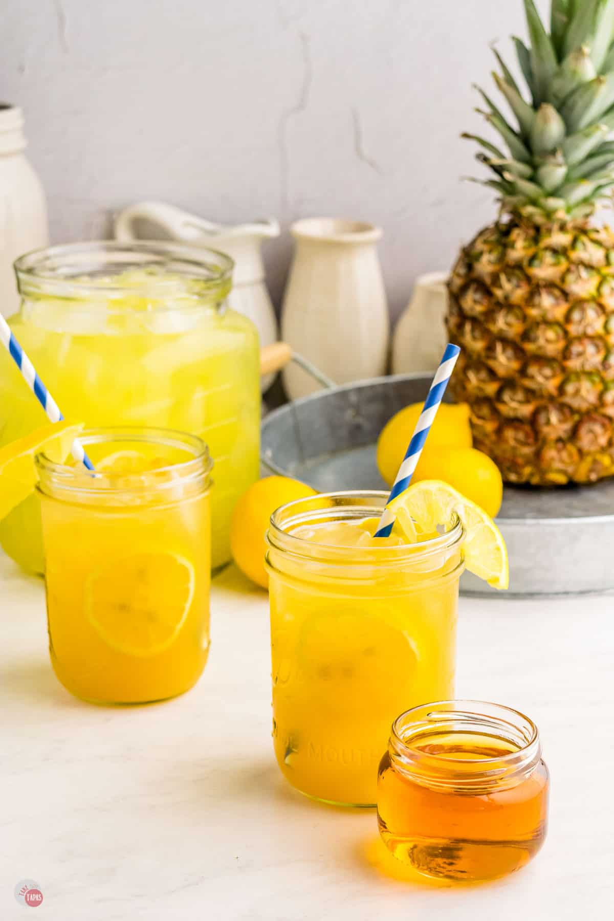 two glasses of pineapple bourbon lemonade