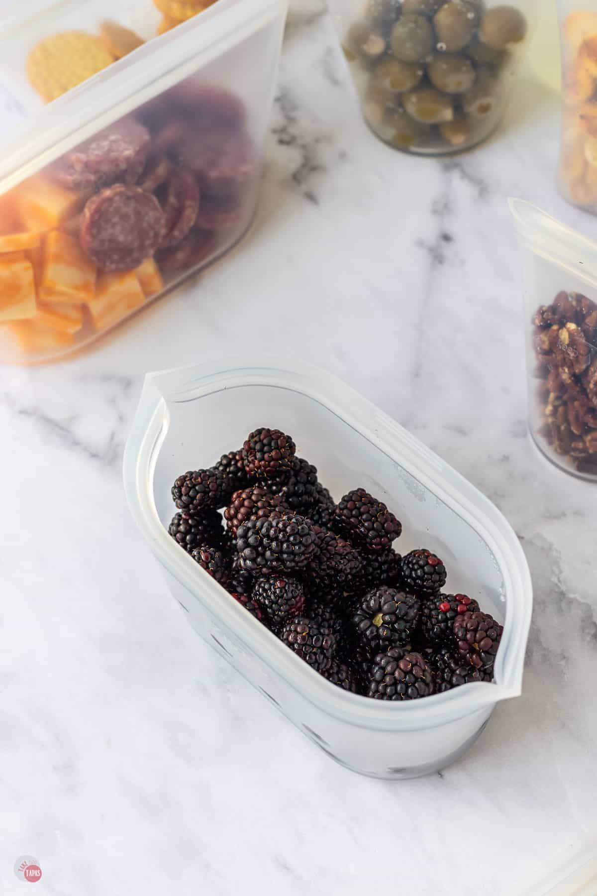 container of blackberries