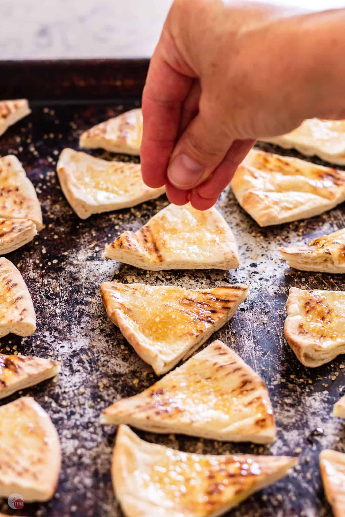 pita chips on a baking sheet