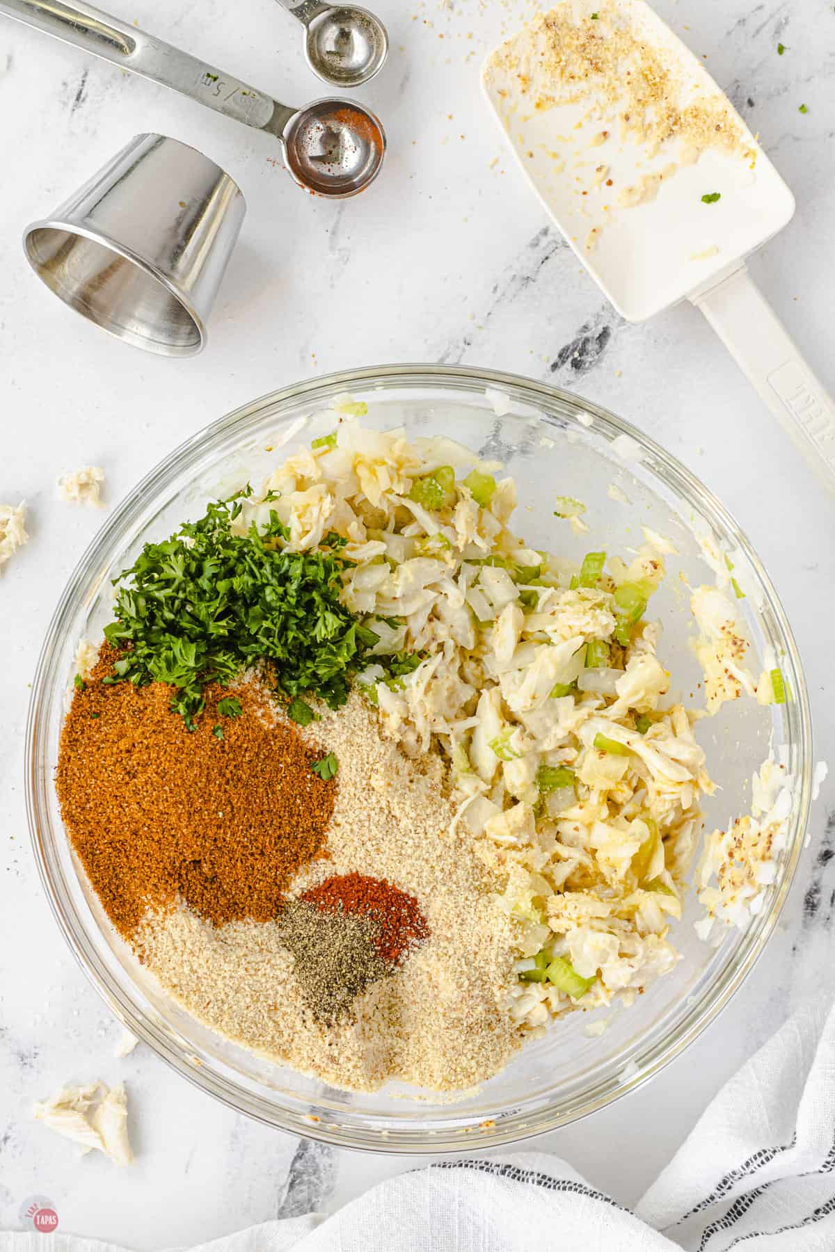 spices and crab in a bowl
