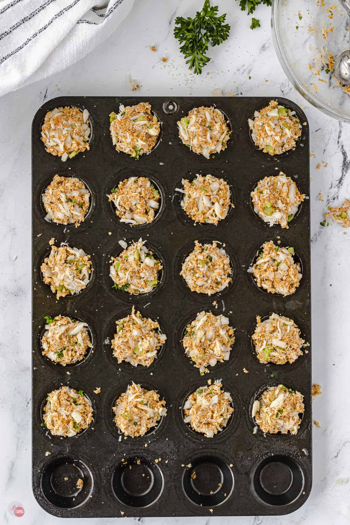 raw crab cakes in muffin pan