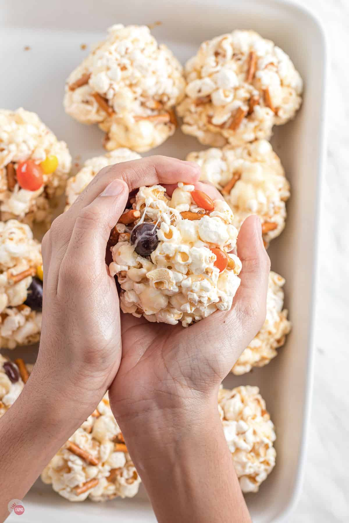 popcorn ball in two hands