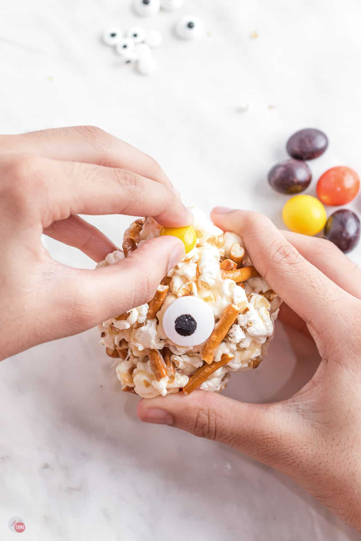 popcorn ball with eyes