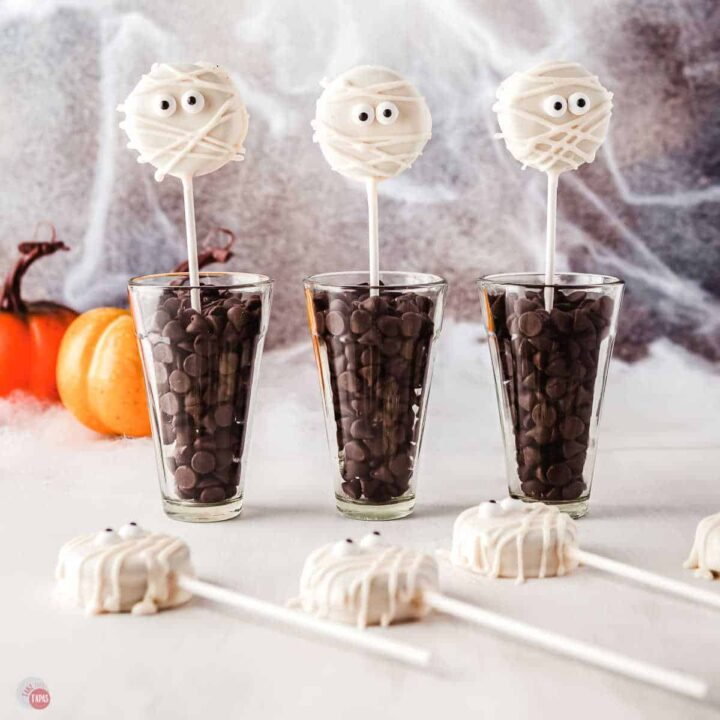 three glasses with lollipops
