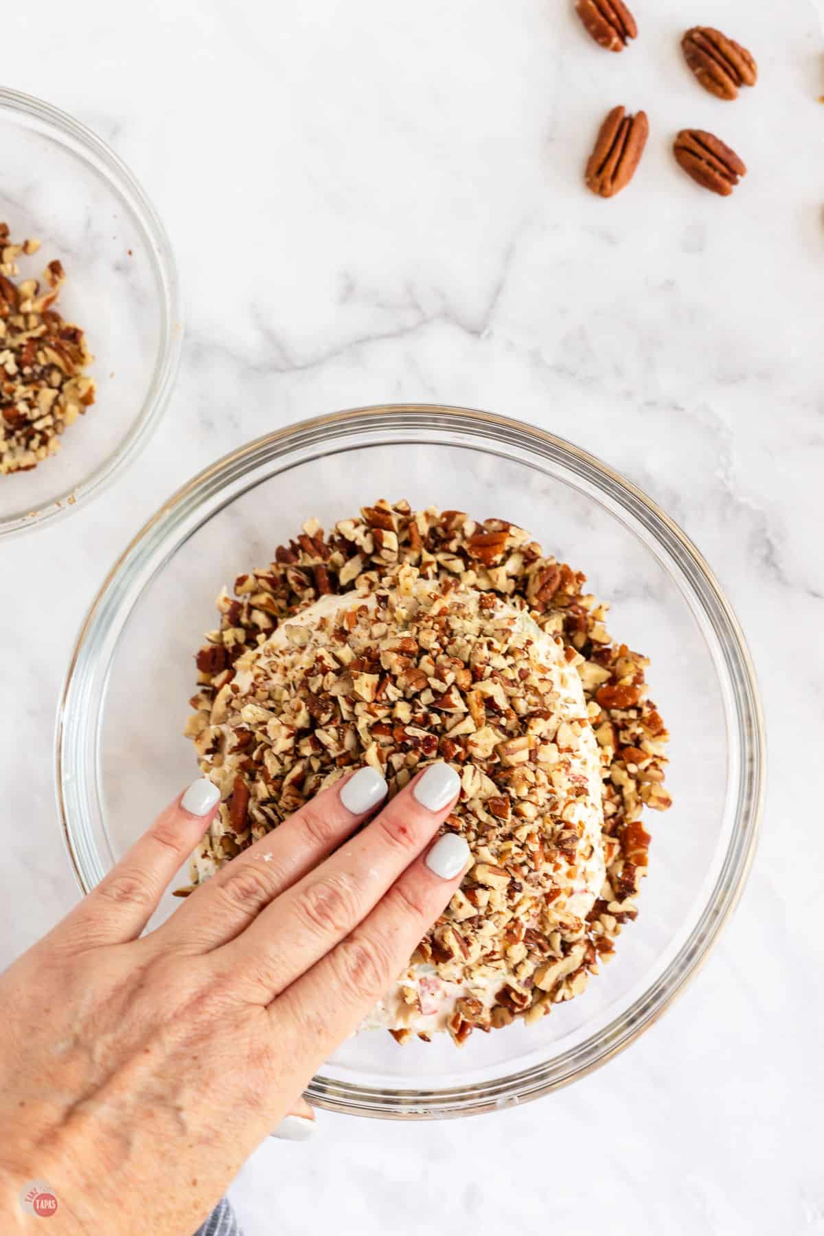hand with pecans
