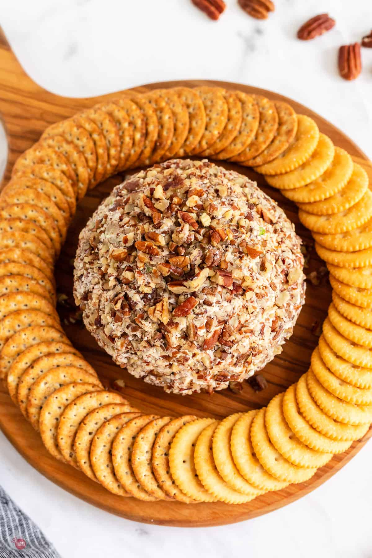 cheese ball on platter with crackers