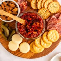 cheese board with jar of tomato bacon jam