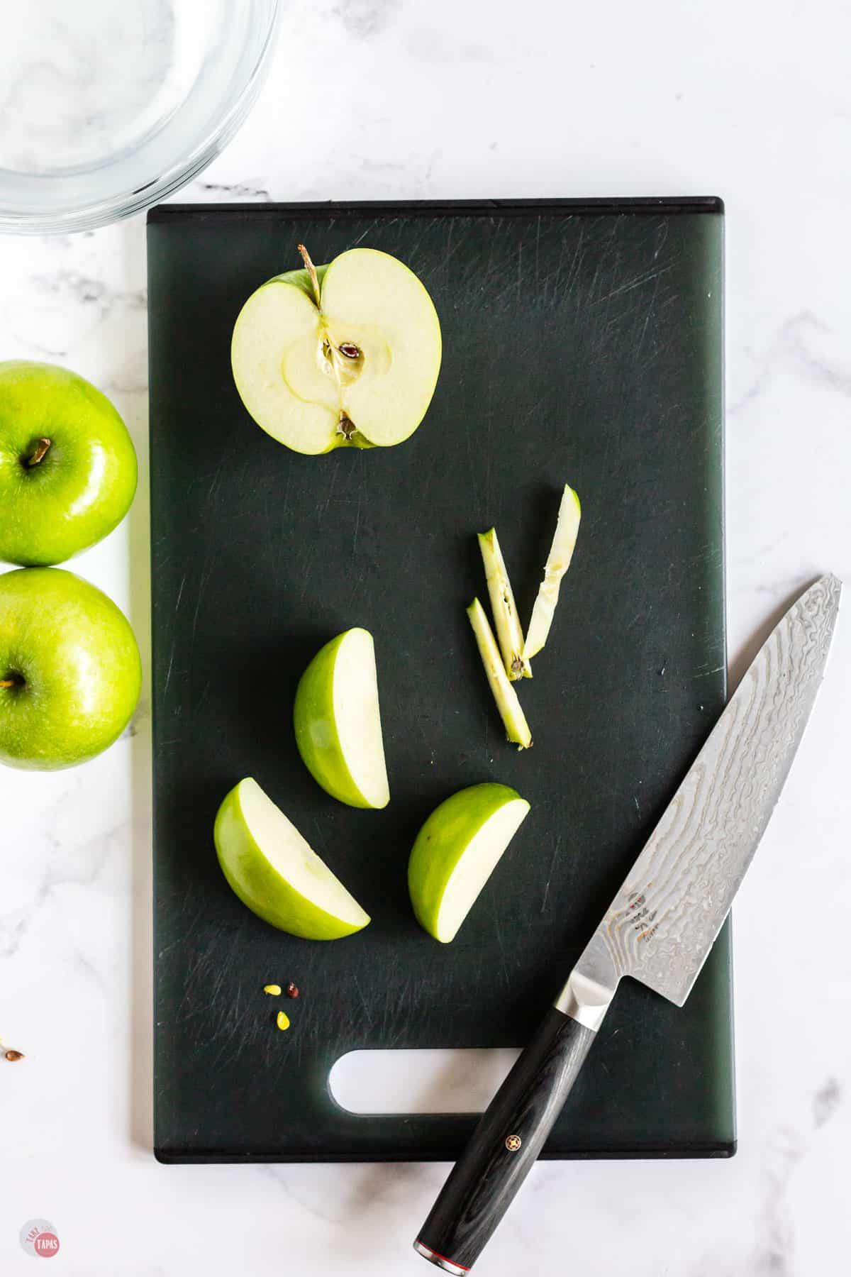 cur apples on a cutting board