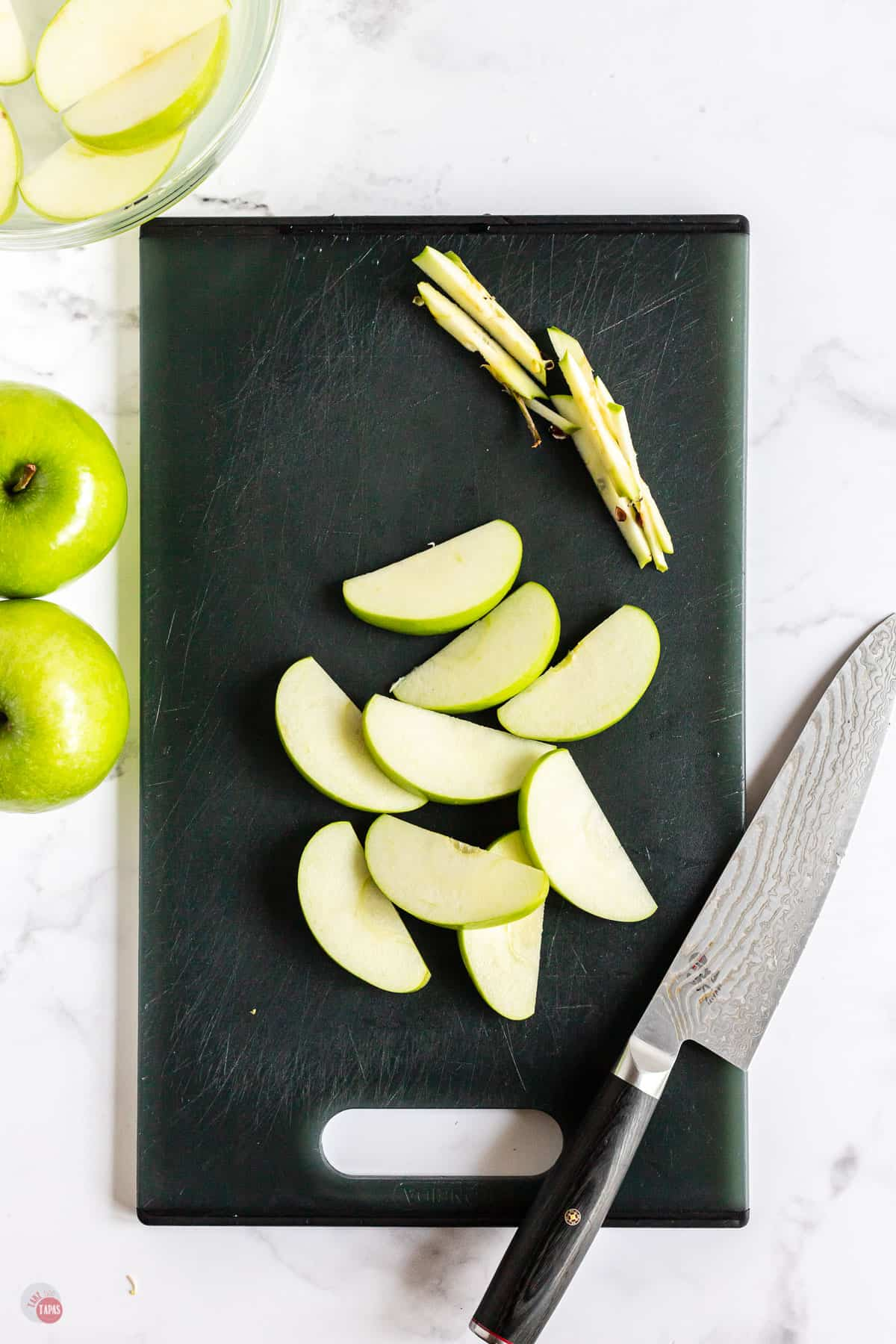 apple slices on cutting board