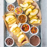tray with apples and toppings