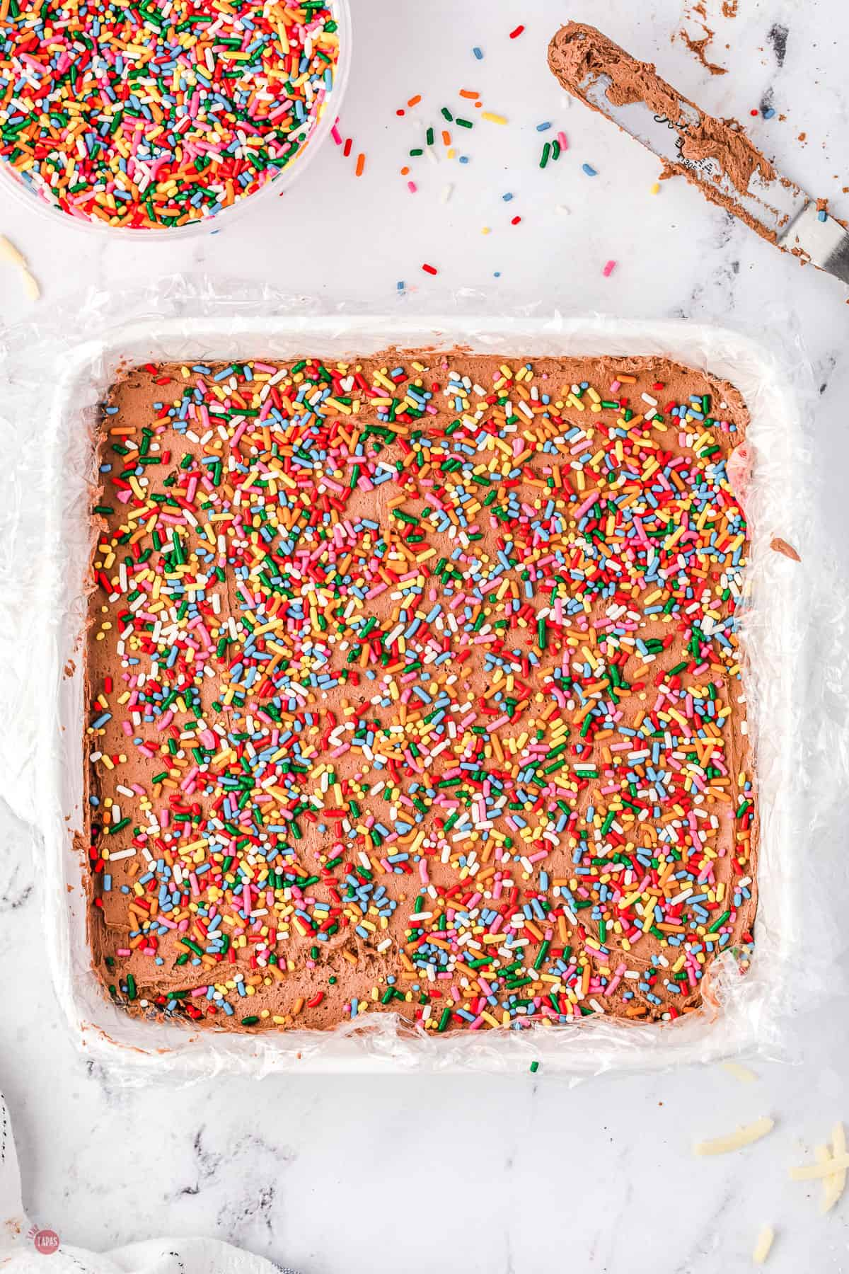 creamy cheese fudge with sprinkles in a pan