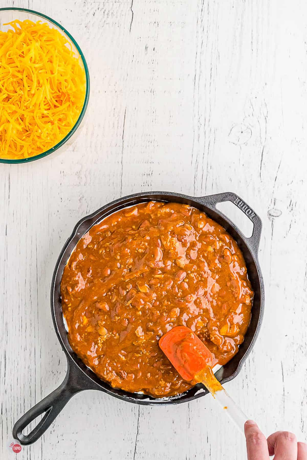 chili in a skillet with a spatula