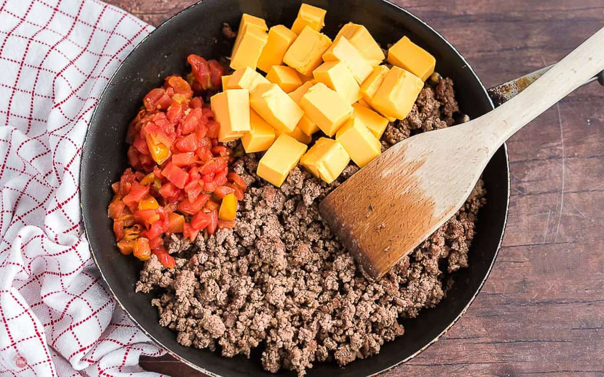 beef and cheese in a pan