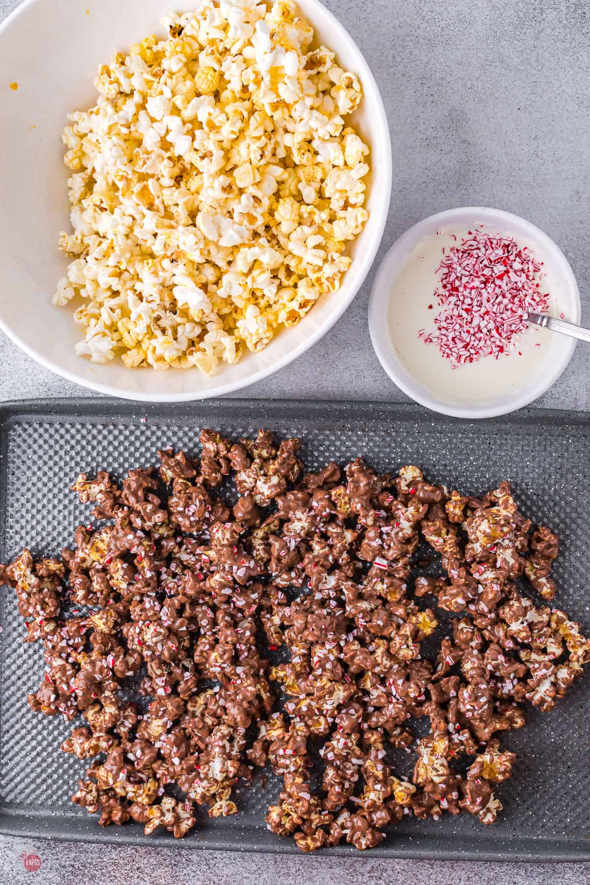 chocolate covered popcorn on a baking sheet