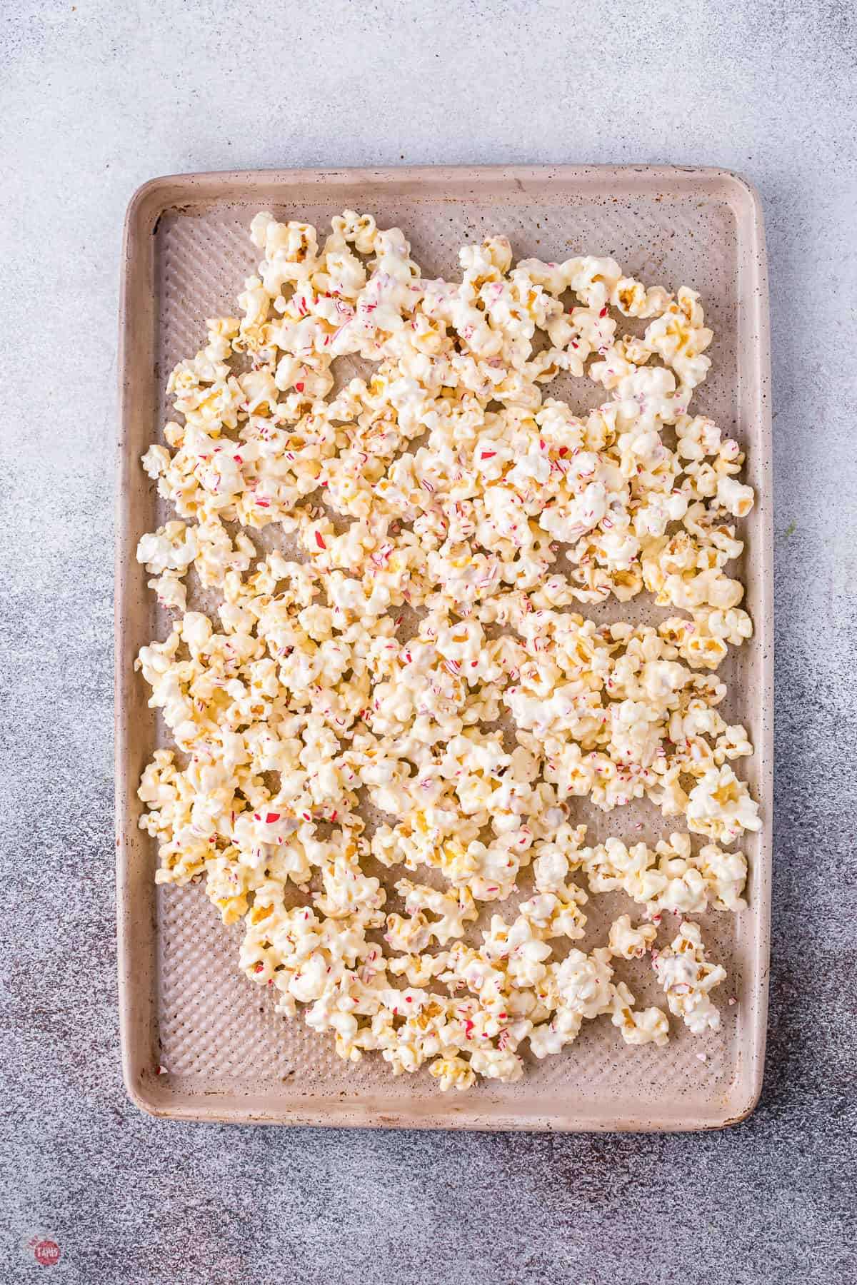 white chocolate popcorn on a baking sheet