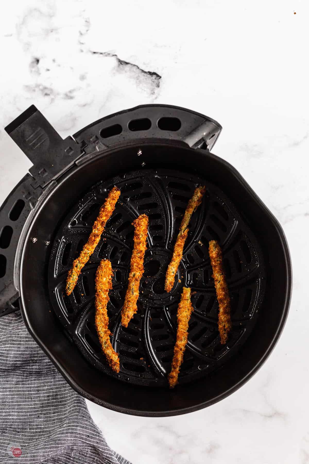 crispy asparagus in an air fryer basket