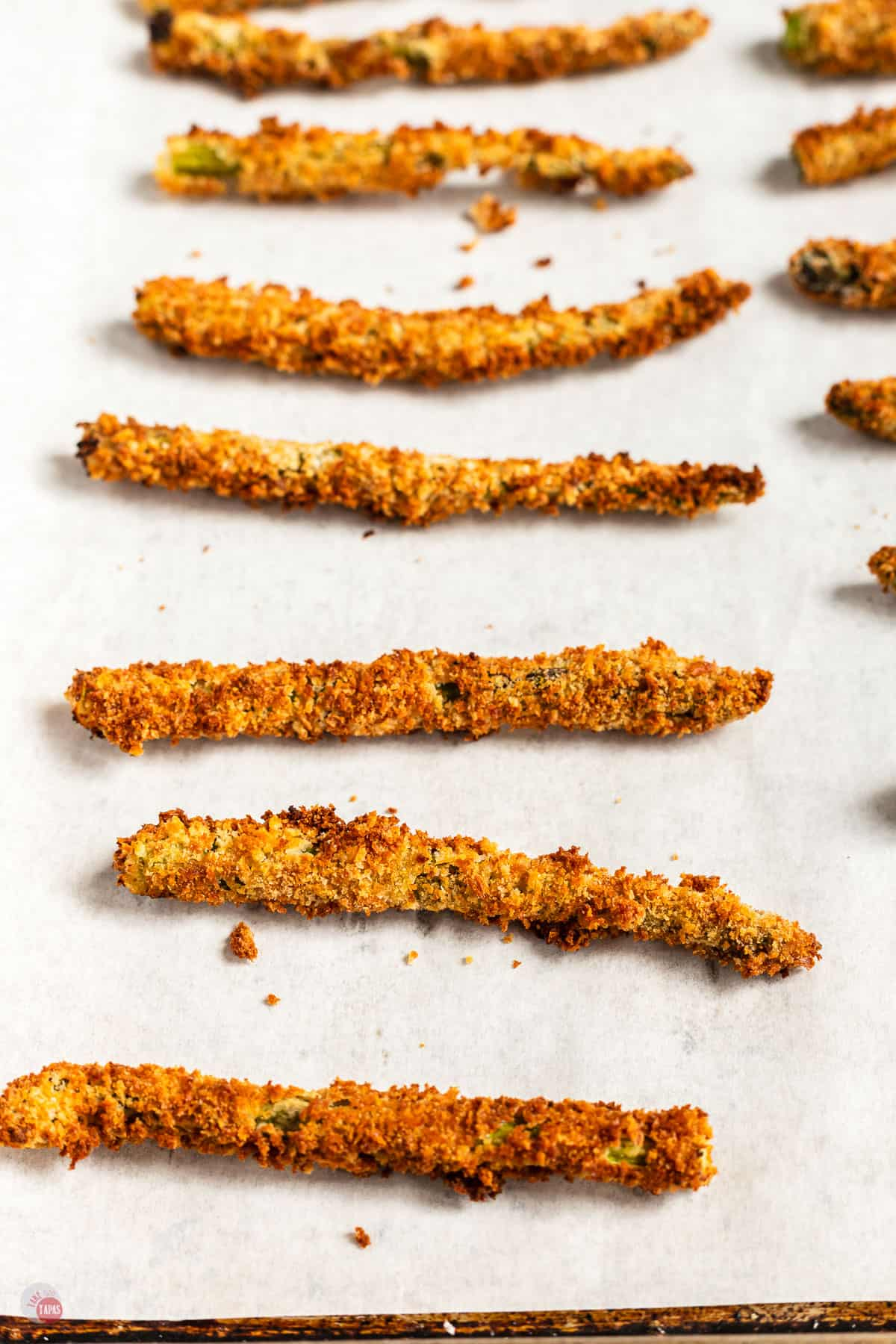 asparagus fries on a baking sheet