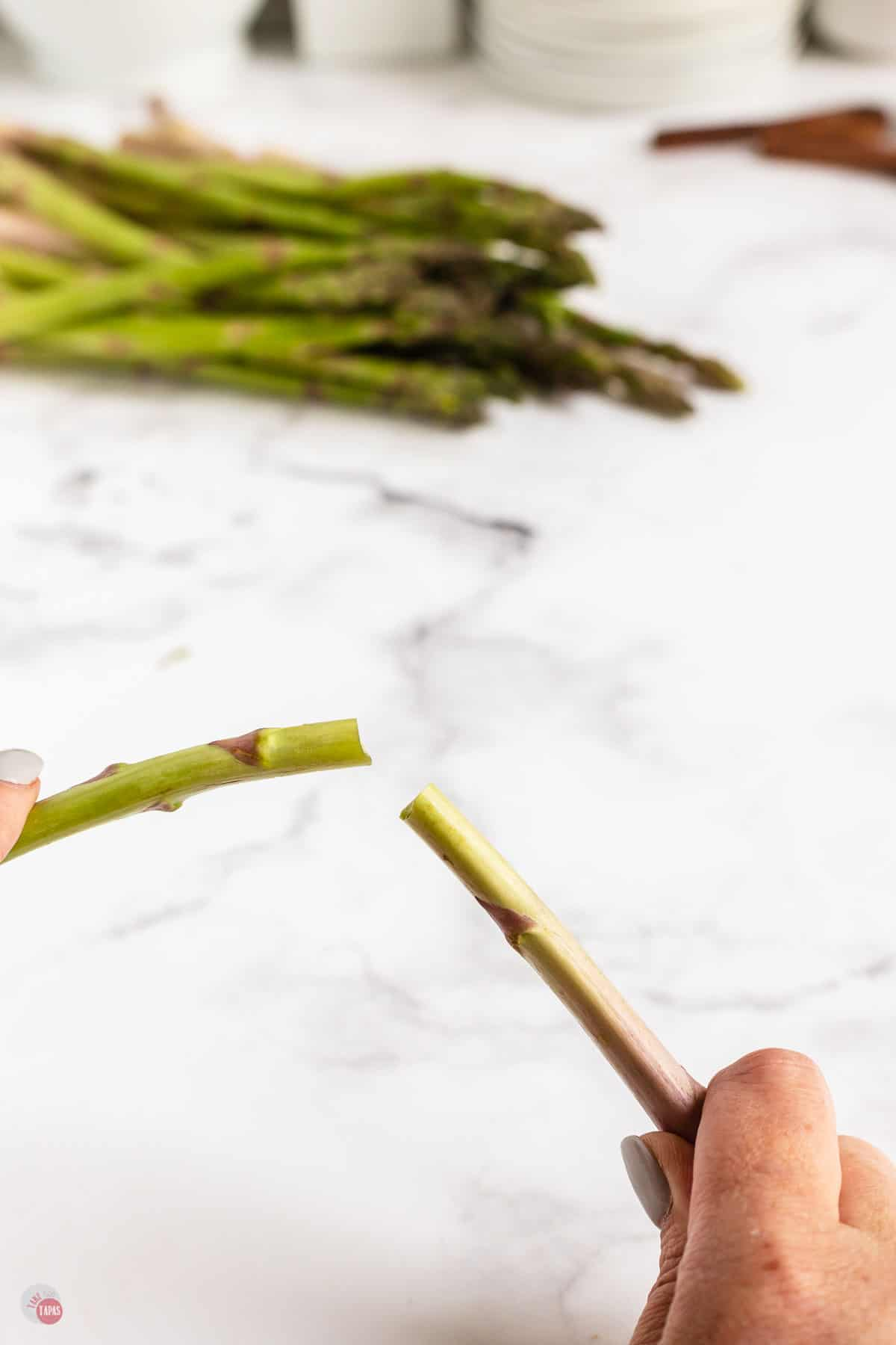 asparagus spear in two hands