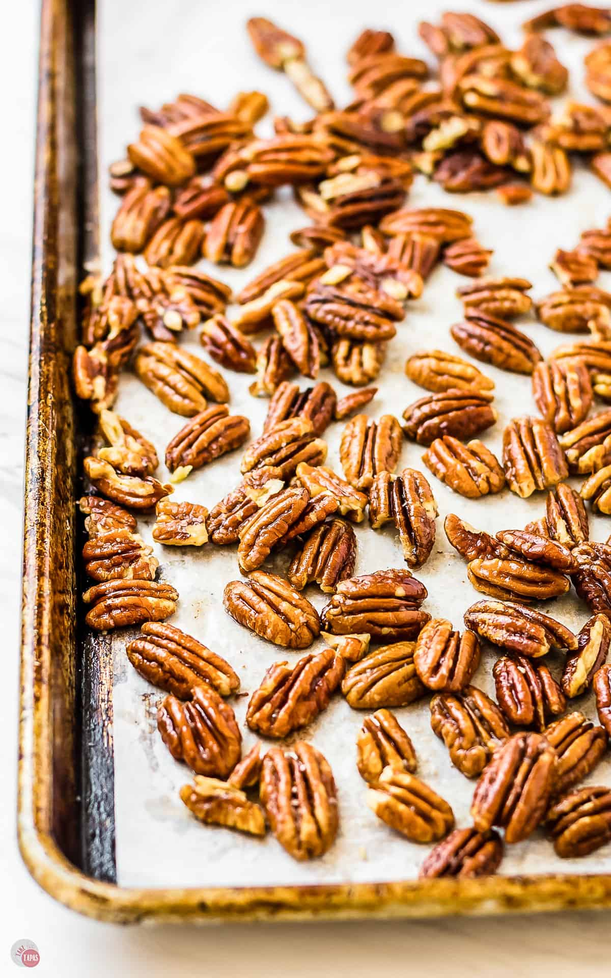 toasted pecans on a baking sheet