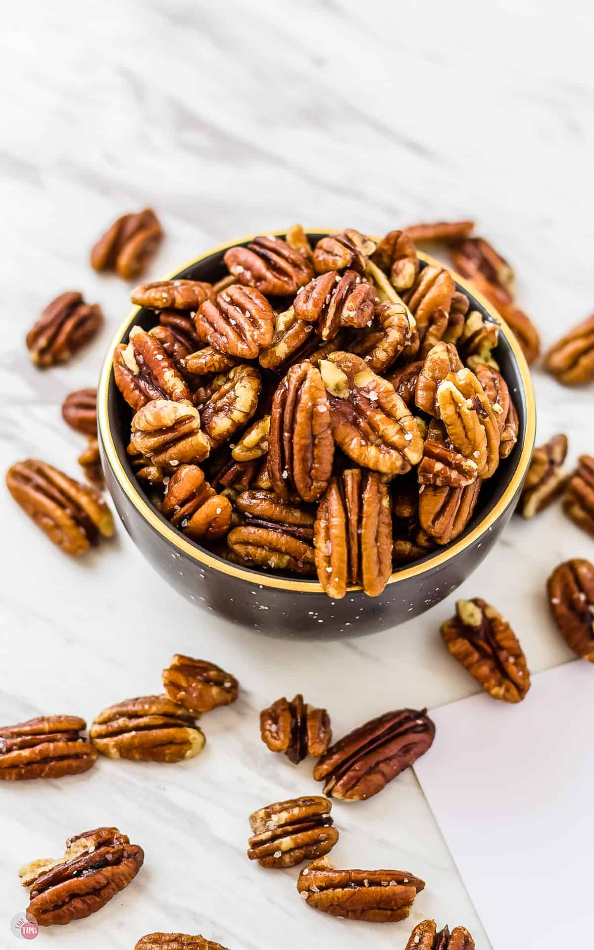 overhead shot of a bowl of perfect buttery toasted pecans